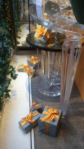 Christmas window display with acrylic console table